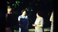 1951: older men and women gathered in a green area preparing to pose WILLMAR Stock Footage