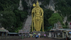 Batu Caves and Murugan statue in Malaysia Stock Footage