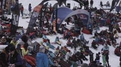 Ski resort. Snowboarders and skiers sitting in encamp. Having rest. Crowds Stock Footage