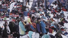 Ski resort. Snowboarders and skiers sit in encamp. Having rest. Shoot on camera Stock Footage