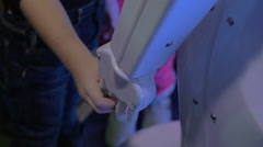 Child holding robot hand. Friendly robotics Stock Footage