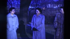 1951: people with long coats are seen talking and posing for the camera WILLMAR Stock Footage