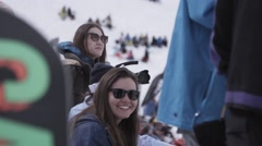 Ski resort. Young girls in sunglasses look in camera in encamp. Mountains Stock Footage