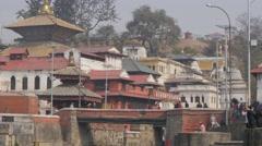 People crossing bridge at Pashupatinath,Kathmandu,Nepal Stock Footage