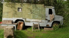 Old Abandoned Truck that Transformed into a Hut. House on wheels.  Stock Footage