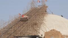 Worker in lift down stupa in contruction,Kathmandu,Boudhanath,Nepal Stock Footage
