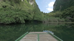 Boat sailing into karst cave. Trang An, Vietnam Stock Footage