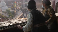 Old buddhist women lighting candles,Kathmandu,Boudhanath,Nepal Stock Footage