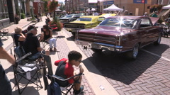 Vintage and antique classic car show on sunny day in the city Stock Footage