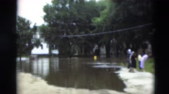 1951: a person is seen passing by water in a green area WILLMAR, KENTUCKY Stock Footage