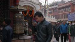 Crowds circling stupa,Kathmandu,Boudhanath,Nepal Stock Footage