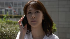 Japanese girl with her smartphone Stock Footage