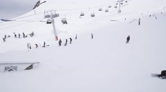 Ski resort. Skier slide on trail, failing. People. Snow mountains. Extreme sport Stock Footage