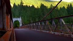4K Dark Abandoned Steel Bridge in Mountain Shadow, Green Forest Background Stock Footage