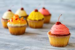 Cupcake with pink frosting. Stock Photos
