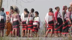 Dancing people in traditional dress and masked man,Chitwan,National Park,Nepal Stock Footage