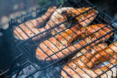 Salmon steaks on a lattice barbecue grill Stock Photos