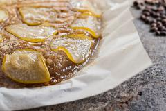 Pie-overturned with coffee and pears Stock Photos