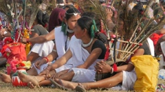 Beautiful dressed women sitting on Festival grounds,Chitwan,National Park,Nepal Stock Footage