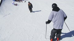 Skier slide on slope, jump on rail. Sunny day. Ski resort. Snowy mountains Stock Footage