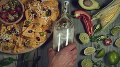4k Traditional Mexican Food and Beer, Putting Bottle Stock Footage