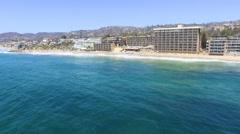 Fly into the Main Beach Coastline, Laguna Beach, Southern California Stock Footage