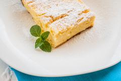 Cottage cheese casserole piece sprinkled with powdered sugar on a plate Stock Photos