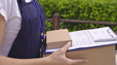 Joyous Delivery Woman Walking with Parcel Stock Footage