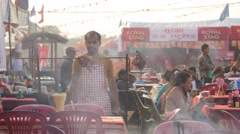Man cooking on festival,Chitwan,National Park,Nepal Stock Footage