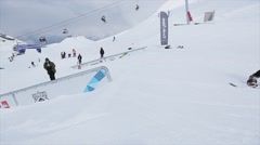 Snowboarder make back slide on iron trail on slope. Landscape. Snowy mountains Stock Footage