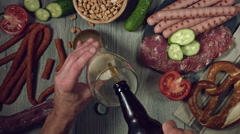 4k Traditional German Beer and Food, Pouring Beer in Glass Stock Footage