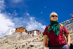 Young man traveler portrait near the Tibet Monastery Stock Photos
