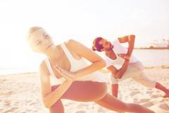 Close up of couple making yoga exercises outdoors Kuvituskuvat