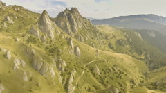 Green valley with mountain peaks Stock Footage