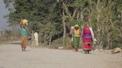 Women bringing grass home on back,Chitwan,National Park,Nepal Stock Footage