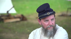 Civil War soldier sits near camp Stock Footage