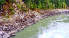 4K Churning River Water and Rocky Embankment on River Edge Stock Footage