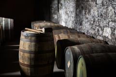 Close up of old wooden barrel in wine cellar Stock Photos