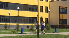 Three colleagues walk through the innovation center and communicate Stock Footage