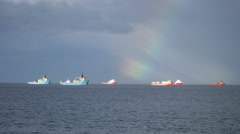 Offshore supply boat and rainbow in the Aberdeen Harbour in Scotland Stock Footage