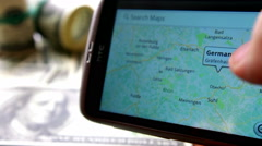 Russia, Orel, male hand using Google Maps looking for streets in Germany Stock Footage
