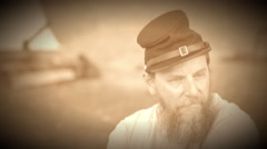 Civil War soldier sits near camp (Archive Footage Version) Stock Footage