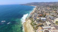 Fly South Along the Coastline in Main Beach, Laguna Beach, Southern California Stock Footage