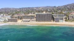Flying along the Coastline in Main Beach, Laguna Beach, Southern California Stock Footage