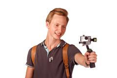 Videographer holds mobile camera on gimbal. Stock Photos