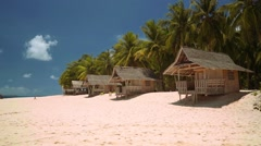 Small bungalows on white sand beach on tropical island - Philippines Stock Footage