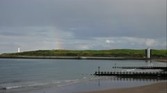 Girdleness Lighthouse and rainbow in the North Sea Aberdeen, Scotland, UK Stock Footage
