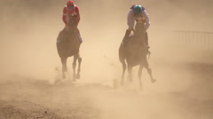 Horse Racing - Two Riders in the Dust. Super Slow Motion Stock Footage