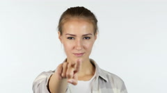 Young girl pointing finger to the camera in front of white background Stock Footage
