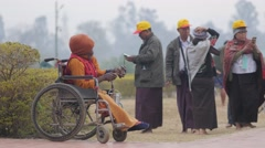 Beggar in wheel chair,Lumbini,Nepal Stock Footage